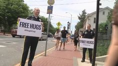 Police give out free hugs in a viral video. (Newark Delaware Police Department Facebook photo)