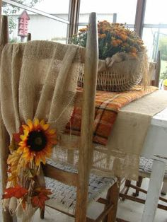 drape it over chairs on the porch, gathering it at the bottom, tied with some raffia and tucked in some fall leaves and artificial sunflowers