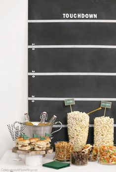 Set up a game day popcorn bar with tasty options and easy add-ins. See the details and get inspired here. Host a Football viewing party or Super Bowl party.  orvillemoment AD