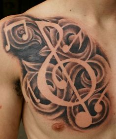 Tribal Music Tattoo On Men Chest