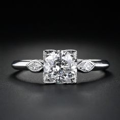 Okay, this is my new favorite ring on Earth! The center diamond is round, but the setting is square. It almost looks like a princess cut. Gorgeous!!!  1.39 Carat Diamond Vintage Engagement Ring - 10-1-4335 - Lang Antiques