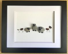 Pebble art depicting a barnyard scene with sheep and flowers. Great for a baby shower gift or nursery decor. 8x10 Mate and chocolate brown natural Wood frame-outer dimensions 13 X 16.