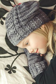 Tupelo is a feminine slouchy hat with an eyelet brim and a patterned panel, which features a single cable between two mock cables and works its way from the brim to the crown. These sweet details add to the fun of knitting and wearing this slouchy little number.