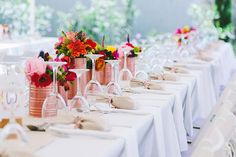 The rose gold painted tin cans make quite a statement against the white table cloth