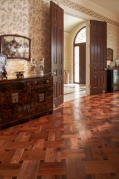 If a single basket weave is good, a double basket weave is even better. This striking floor was created of American black walnut, scraped by hand and waxed to bring out the beauty of the wood and its rich patina. End-grain pieces of the same walnut were used to create the inlays.