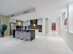 Photo of a modern open plan kitchen using frosted glass from the kitchen image galleries - Kitchen photo 7495273. Browse hundreds of images of modern kitchens & photos of open plan kitchen designs.