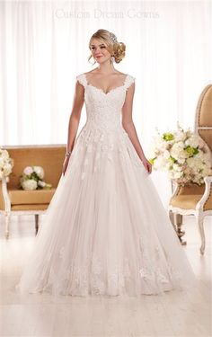 2016 Elegant Lace & Tulle Over Satin A-Line Ball Gown with a Sweetheart Neckline, Lace Cap Sleeves, Lightly Beaded Lace Fitted Bodice, Chandelier Lace Appliques Through Gathered Tulle Skirt,  Chapel Train, Back Covered Button Over Hidden Zipper Closure. #weddingdress #sayyestothedress #customweddingdress #ballgown #lacewedding #romanticwedding #beautifulweddingdress #2016wedding #weddingfashion #weddingstyle #bridalgown #chapel #sweetheart #dreamwedding #dreamdress #elegantwedding #couture