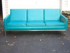 Turquoise vinyl 70's couch.