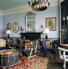 The Jura Lodge - Look at the coffee table and the purple chair and crown molding and the chandelier and those baby blue walls and....+++!