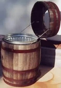 Great way to use a barrel to hide a trash can