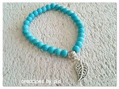 Check out this item in my Etsy shop https://www.etsy.com/uk/listing/249852931/turquoise-leaf-charm-bracelet