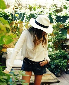 Lovely spring get up - white shirt, fedora and black cut offs.