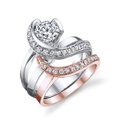 It's Two Tone Tuesday! Vision engagement ring in white gold with the matching diamond band in rose gold. Which ring do you think would look great in two tone?