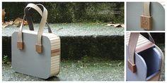 Bolso de madera con asas de cuero
