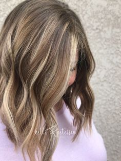Medium brown hair with blonde balayage with a lob cut