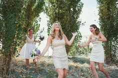 Trying to get down the hill gracefully in their pretty dresses. Weddings by Mary-Theresa