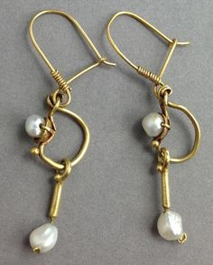 Roman Gold and Pearl Earrings A pair of ancient Roman gold loop earrings with inset antique pearls and pearl drops, on modern gold loops. Ca. 1st - 3rd century AD. Height: 2 in. (5 cm). Intact and wearable.