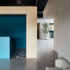 """Small and simple office building which fits seamlessly into the surrounding area, built within a limited construction budget. Laconic but sophisticated inner structure contains spatial intrigues, diverse use options and different atmospheres — semi-open office space accommodates few office rooms — """"boxes"""" along with spaces in-between them, usable for other supporting purposes — meeting rooms, a silence room, resting space, a play room, a kitchen and a dining room with a terrace. Open Space Office, Meeting Rooms, Office Interiors, Playroom, Terrace, Entrance, Boxes, Dining Room, Budget"""