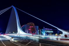 A long exposure on the Samuel Beckett Bridge, Dublin. I like the couple standing in the bottom right hand corner, contrasting against the white of the bridge. They add character that the other shots without people lacked. Dublin at night. Samuel Beckett Bridge, Long Exposure, Dublin, Contrast, Shots, Corner, Gray, Night, Couples
