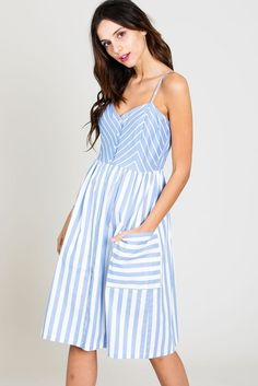 This adorable dress is perfect for Easter and features a button down front, spaghetti straps, and contrasting stripes. With 2 front oversized pockets, adjustable straps, and smocked back with elastic waistband you cannot go wrong.