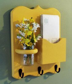A place to put your mail, hang your keys, and put some flowers or whatever you'd like to brighten your day.