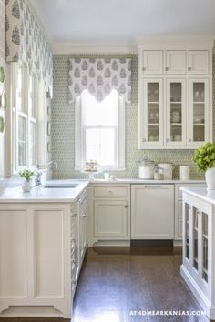 Down to Earth | At Home In Arkansas. MH Design, Inc. Melissa Haynes Design, Cutest kitchen ever! Custom designed, locally crafted cornices over the windows, with antique china plates on the wall. Custom designed layout and cabinets. White cabinets, apple green backsplash, dark stained wood floors :) Photo by Rett Peek.