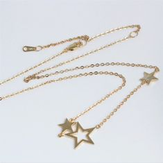 Wish Upon a Star Delicate triple star necklace in sterling silver, rose gold or gold vermeil. Fully adjustable so can be worn as a choker, collar or longer.  Pair with your favourite necklaces for a layered boho look#jewellery #jewelry #star #necklace #silver #gold #wedding #boho  #three #rosegold #choker