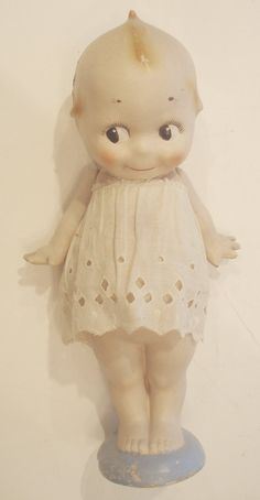 COMPOSITION KEWPIE DOLL.
