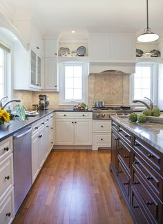 love the backsplash above the cook top! white and brown kitchen