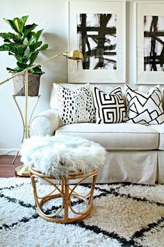 Living room with black and white, a fur stool, and a beni rug