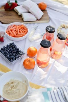 Easy DIY drink bottles to keep drinks and water organized!! Perfect for events, picnics, birthday parties, road trips and we even use them at home so our kids don't keep reaching for a new cup every time they need a drink!