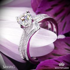 A classic chic duo the Simon G MR1609 Caviar Diamond Wedding Set offers style and elegance.