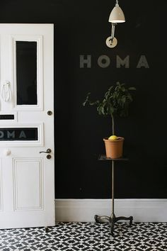 hallway - black walls and black and white tiles - entrance to Homa - east london via Park & Cube