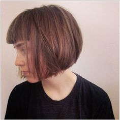 """Feeling daring? This bob will do the trick. We love the sharp edges and how it falls perfectly on the jawline, exposing the neck. """"This look is a strong bob with lots of texture on the interior. We removed length and layers and weight on the interior, and texturized the interior to keep movement and lift in the hair. Beneath this cut, [we did] an undercut with a straight razor, so [the model's] neck is bare. A strong bang keeps this look youthful and updated,"""" says Reyman."""