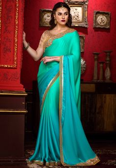 Satin Georgette Saree in Ombre Turquoise This drape is enhanced with Zari, Sequins, Thread and Patch Border Work Available with an Art silk and Net blouse in Beige Free Services: Fall and Edging ( Pico) Do note: Accessories shown in the image are just for presentation purpose only. (Slight variation in actual color vs. image is possible).