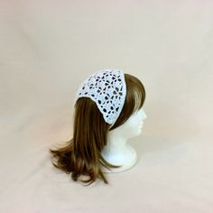 A white and silver kerchief is a great hair accessory. Crocheted in white with flecks of silver, this lace bandana headband scarf will keep your hair out of your face. The rockabilly hair tie acts like a headband but gives you more detail with its triangle lace pattern. The widest
