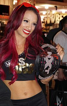 Sasha Banks (1992 - ) March 2015.jpg - an American professional wrestler currently signed to WWE under the ring name Sasha Banks, where she is a former NXT Women's Champion.  She previously wrestled on the independent circuit under the ring name Mercedes KV, most notably for Chaotic Wrestling, where she once held the Chaotic Wrestling Women's Championship.