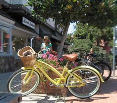 Love this yellow beach cruiser with flower detailing and basket!