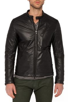 Roberto Leather Moto Jacket with Quilted Sleeve in Black. This is a Nice Style  Mens Leather Jacket made with Lamb  Semi aniline  Soft and Supple Leather.  100% Genuine Leather Lambskin leather Two-way front zip closure Mandarin collar with snap Expandable zip sleeves Quilted panels on shoulder and sleeves Fully lined Dry clean by leather specialist FREE SHIPPING #leather #leatherjackets #mensjackets #maritimeleather #womrnsjackets #hooded #leatherbags #joanel #UGOSantini