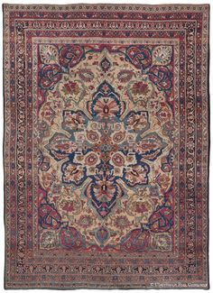 LAVER KIRMAN, Western Persian, 8ft 0in x 11ft 1in, Late 19th Century. Thrilling dimensionality is achieved through expert color striation in the Prussian blue in the majestic medallion of this stunning room size Persian carpet.This antique art rug adds further surprise through its buff toned field and an exotic array of European and earth-toned hues, including taupe, celadon, and terracotta in the center.