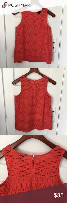 J. Crew Coral Seamed Shell in Zigzag Eyelet J. Crew Coral Seamed Shell in Zigzag Eyelet. Beautiful twist on typical Eyelet pattern on this sleeveless tank style top. Keyhole back. 100% Cotton.  Great coral hue.  True to size. Partially lined.  Very good used condition; very minor signs of wear.  Make me an offer 😉 J. Crew Tops Tank Tops