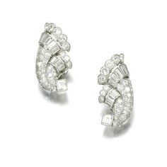 PAIR OF DIAMOND EAR CLIPS, CARTIER, 1930S Each of cornucopia design set with circular- and single-cut diamonds, accented with baguette diamonds, signed Cartier London and numbered.