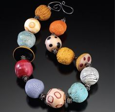 polymer clay and wire necklace by Ronna Sarvas Weltman - from The Mechanics of Jewelry Design: Make Bracelets, Necklaces, and More That Stay Put - Jewelry Making Daily