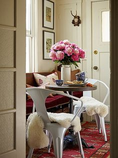 We love how this breakfast nook brings together a vintage church pew, industrial seating, and a petite café table to take full advantage of the space.