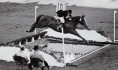 Pat Smythe and Flanagan leaping over an impressive water jump during the 1956 Stockholm Olympics