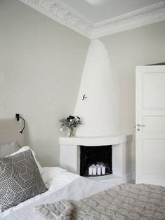 How I'd love a fireplace in my bedroom like the one in this calm Swedish home. Stadshem.