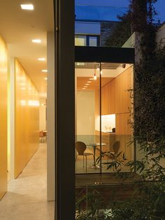 architect cross sectional night time view of glass walled house with internal gold leaf wall