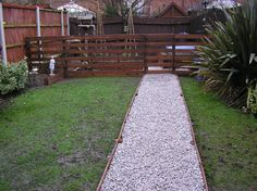 Pallet fence, crushed rock walkways, raised beds