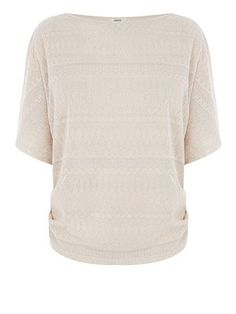 4ea8a578816f The flattering high neckline and gently ruched seam make this top ideal for  on or off-duty chic.