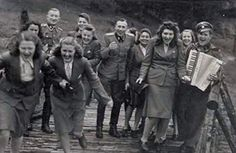 The killers of Auschwitz having a good time in between exterminating tens of thousands each day. The laughing - smiling females are all guards who became notorious for their brutality and blood thirstiness and who often killed prisoners for a laugh or for winning a bet.